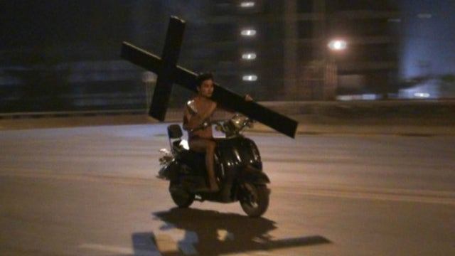 Oh Hey, It's a Naked Man on a Scooter, Carrying a Crucifix