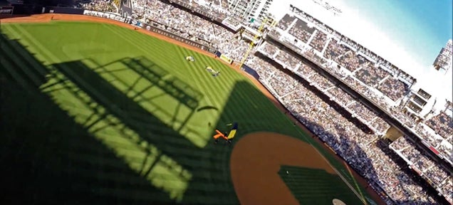 Watch the Navy parachute team jump and land inside a baseball stadium