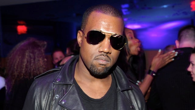 Kanye West Threw Money In The Air At His Fashion Week Party