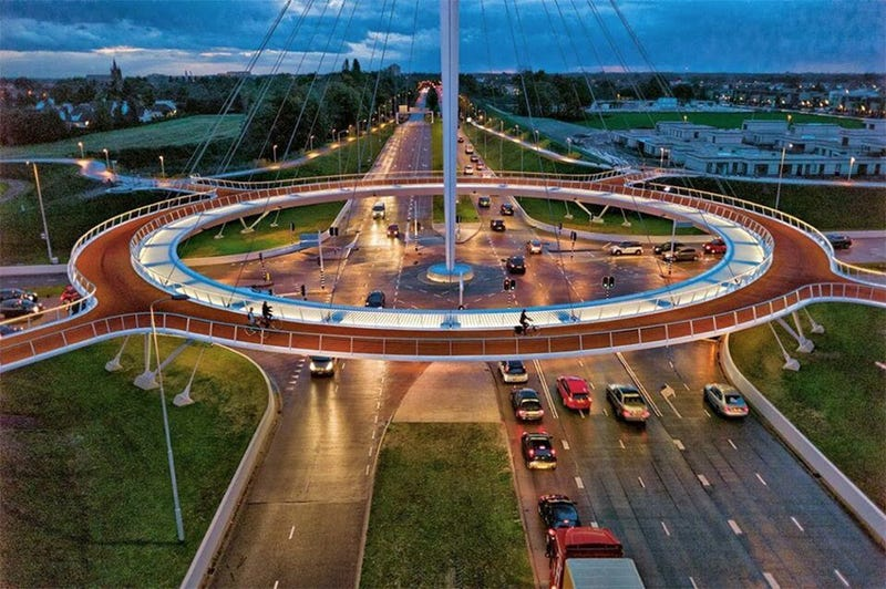 A Floating Suspension Bridge That Lets Cyclists Sail Over Car Traffic
