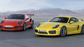 [Here are the Porsche 911 GT3 RS and Cayman GT4 just hanging out together like best friends do. Don't get in trouble you crazy kids!]