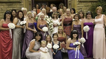 Woman Walks Down The Aisle With 30 Bridesmaids
