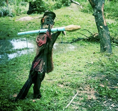 Cambodian scarecrows keep out malicious spirits using ghost bazookas