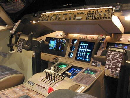 Man Builds $30,000 Jumbo Jet Simulator in his Bedroom