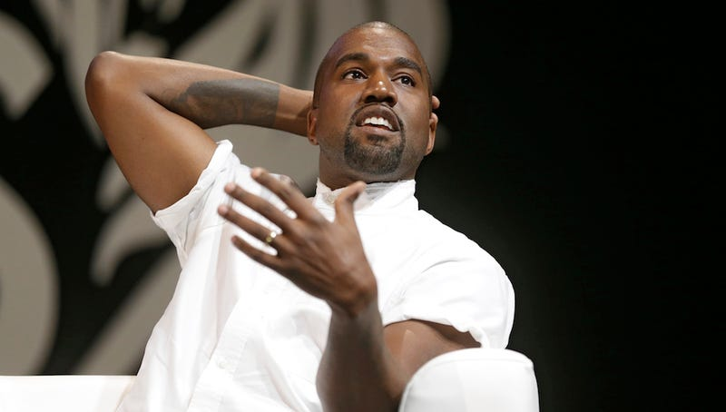Kanye West Insists He Can't Hate the Paparazzi Because His Dad Was One