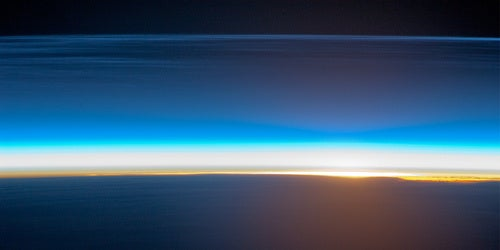 The layers of Earth's atmosphere, illuminated by sunrise