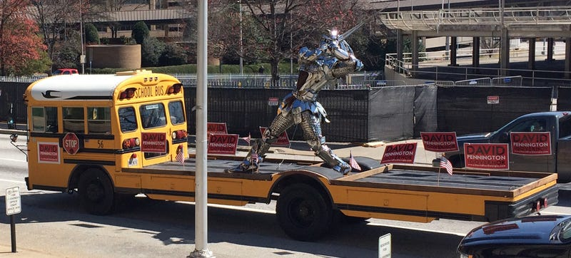 Flat-Bed School Bus Carries Chrome Knight, Political Message Around GA