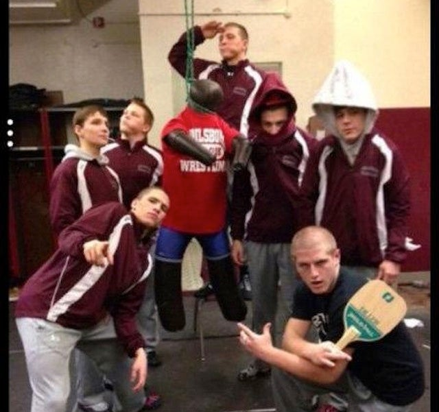 High School Wrestlers Wearing Pointed Hoods Lynch Rival In Effigy