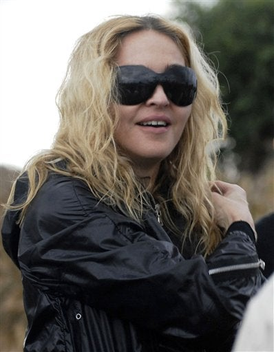 Madonna's Adopted Child Has A Posse