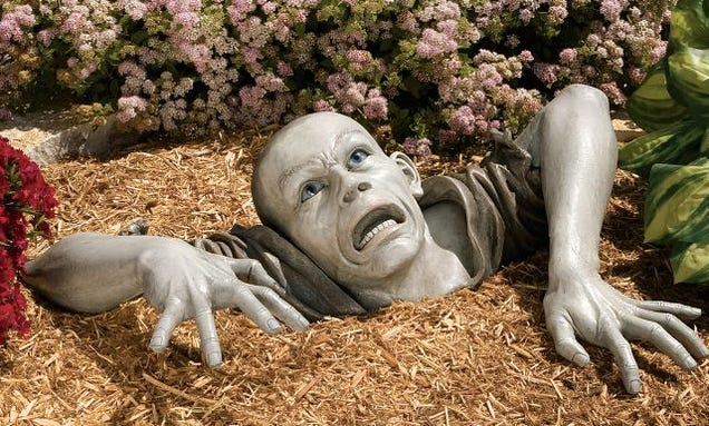 Zombie Garden Sculpture Keeps Zombie Eating Brains Art