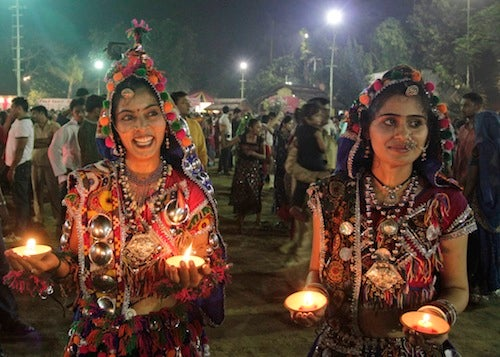 Women Carry The Traditional-Dress Torch