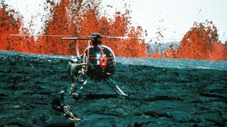 Get to the chopper! Geologists from the Hawaiian Volcano Observatory rush to board a helicopter as fountains of lava erupt in the background, in the 1984 eruption of the Mauna Loa volcano in Hawaii. This picture was recently featured in the U.S. Geological Survey's #ThrowbackThursday series. (Photo: R.B. Moore.)
