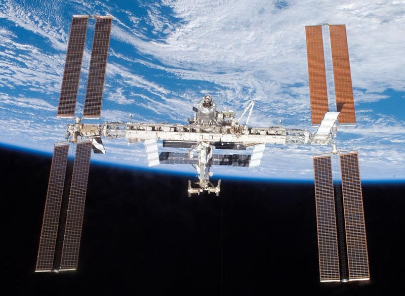 Space Station Crew Climb Into Escape Module To Avoid Passing Space Debris