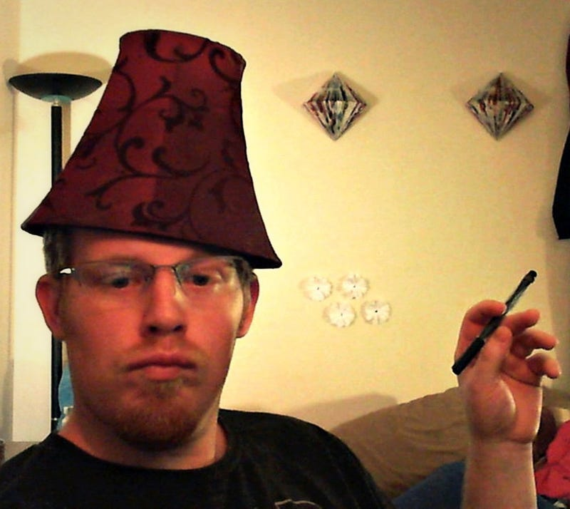 It's not a lampshade. It's a fez. A Psychic Fez.
