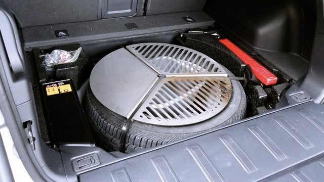 A Campfire Grill That Hugs Your Spare Tire For Easy Storage
