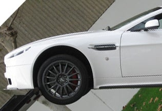 This Is Not The Proper Way To Unload An Aston Martin