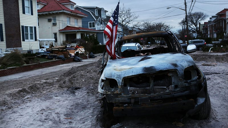 A Burned Truck Holds An American flag In Rockaway, Queens