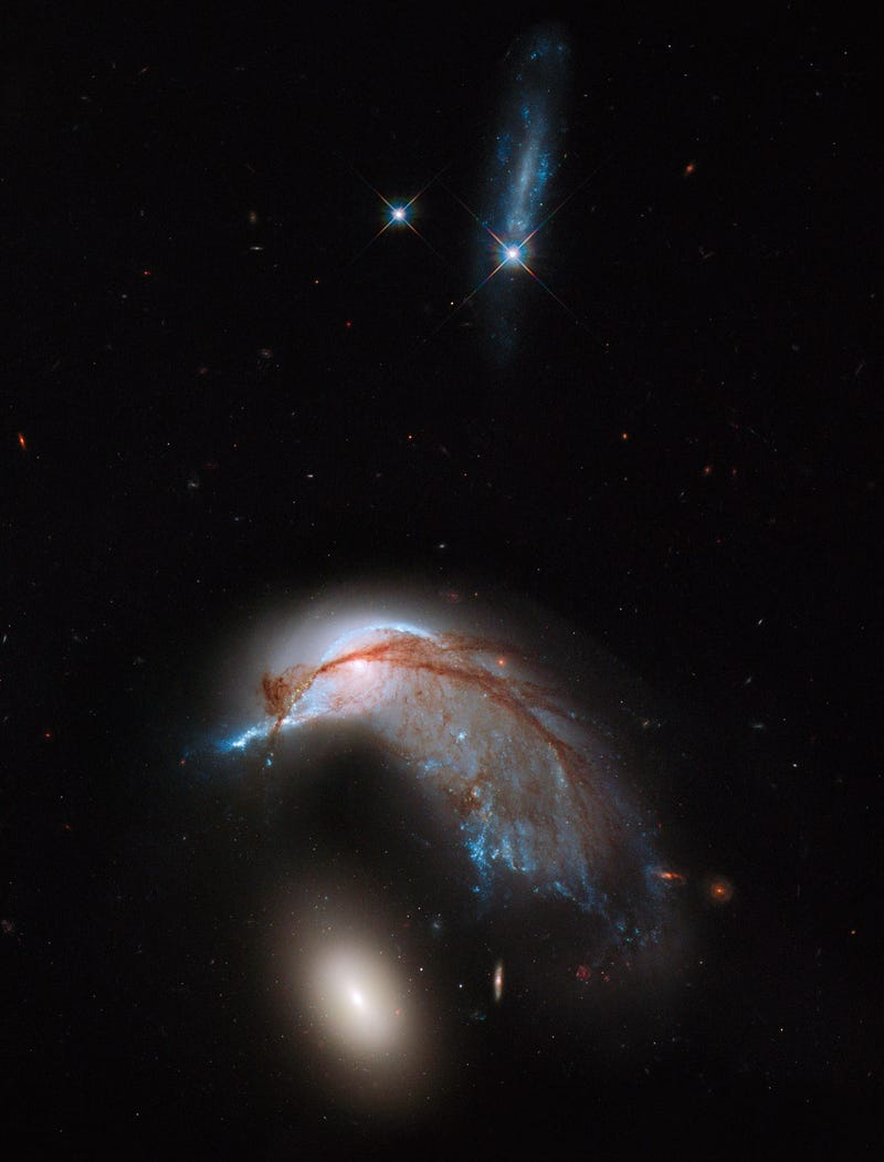 Colliding galaxies take on the shape of a penguin guarding its egg