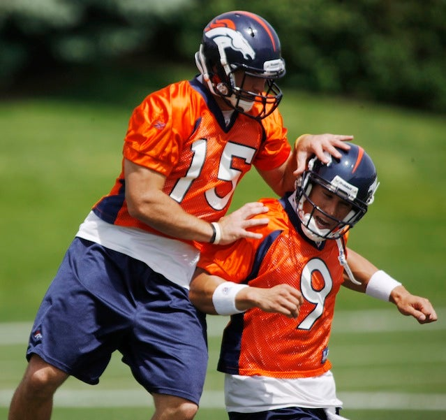 Someone's Trying To Stop The Tim Tebow-Brady Quinn Catfight