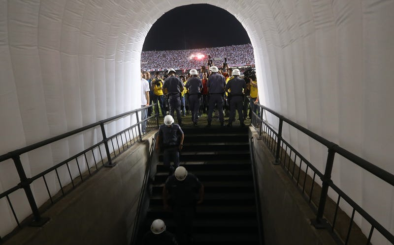 A Soccer Match Between Teams From Argentina And Brazil Ended Early Because Police Beat And Threatened The Argentine Team In Their Locker Room At Halftime