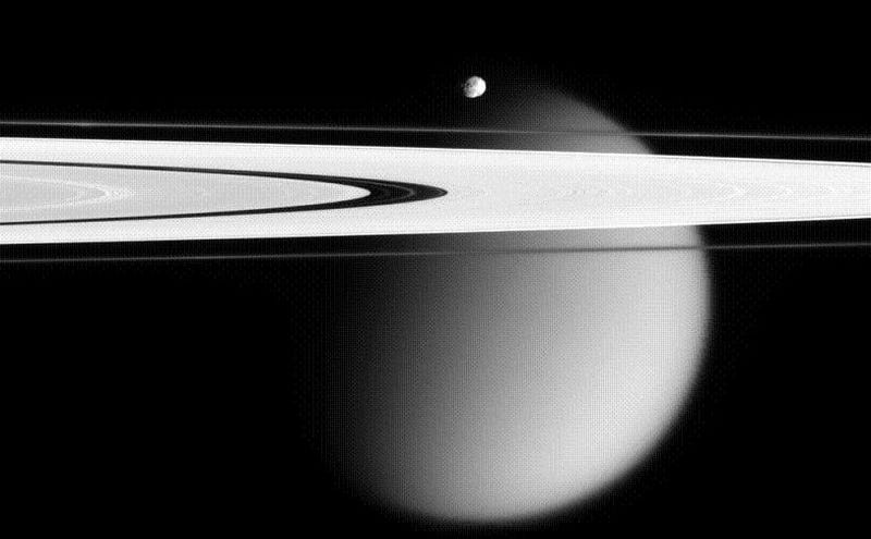 Titan Rises Behind Saturn's Rings