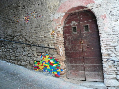 Artist Repairs Walls In Italy With Lego Bricks