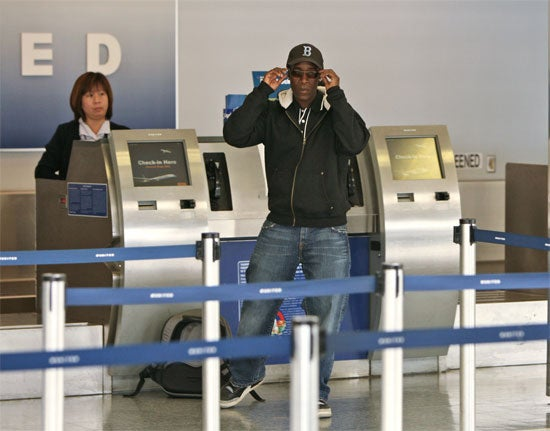Check-In Agent Is Not Impressed With Don Cheadle