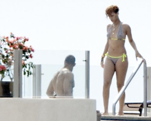 Every Time a Man Touches Rihanna's Butt, a Paparazzo Gets His Wings