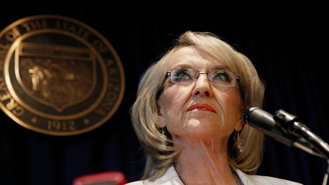 Arizona Governor Jan Brewer's Present Location Is Being Kept Secret, So Let's Just Go Ahead and Guess