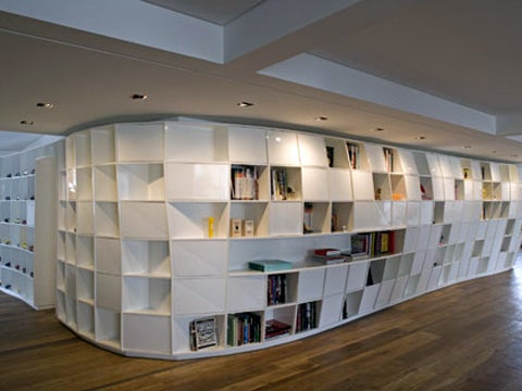 Giant Curvalicious Bookshelf Winds Its Way Through Your Apartment