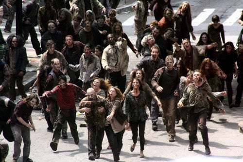 It's zombies, tanks, and Frank Darabont in the first on-set footage of The Walking Dead