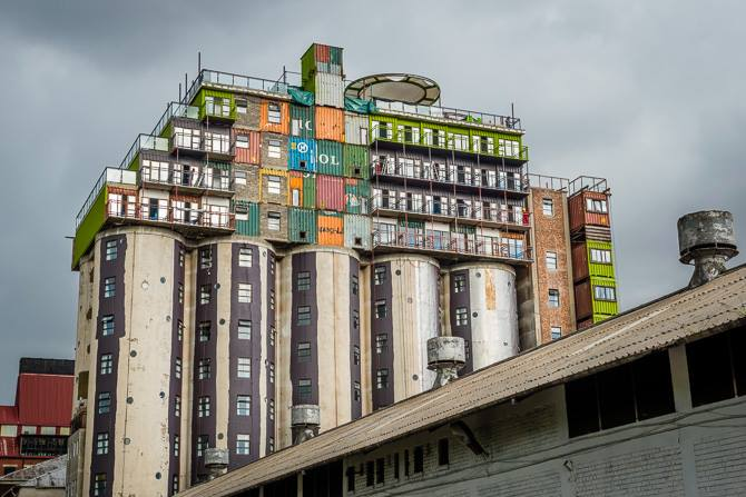 This Shipping Container City Above an Old Grain Silo Is Actually a Dorm