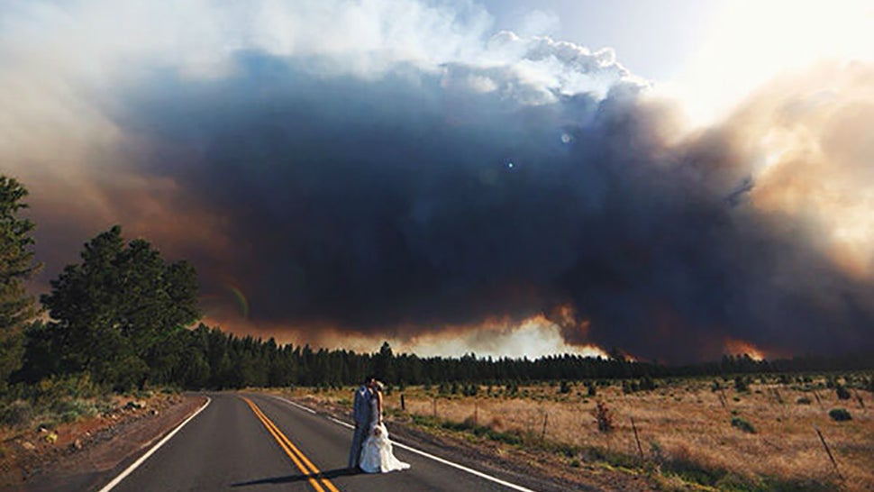 Couple Uses Raging Wildfire as Backdrop for Wedding Photos