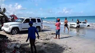 Watch Hapless Goofs Try To Rescue A Camaro They Dumped In The Ocean