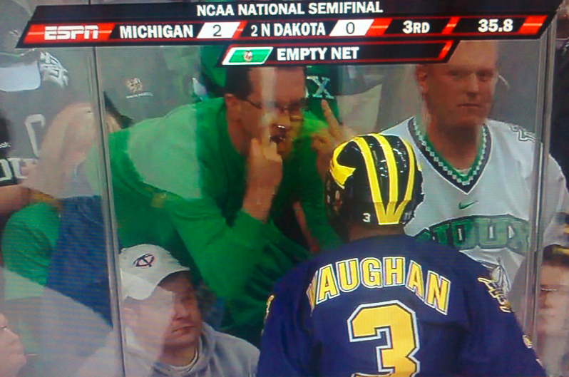 It Sure Looks Like This North Dakota Sioux Hockey Fan Has His Jeaned Ass Square In His Wife's Face