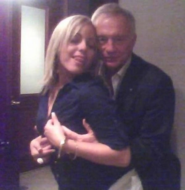 Here's A Lady Rubbing Her Face On Jerry Jones's Crotch