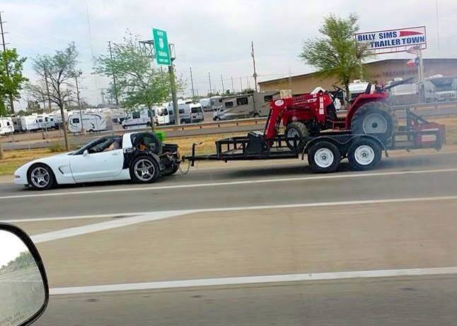 Corvette towing a tractor....