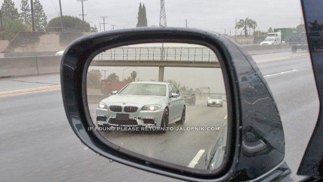 2012 BMW M5 plows through the rain