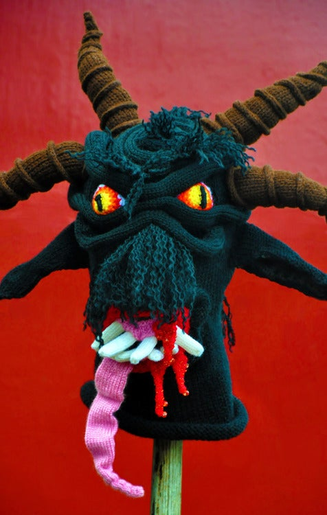 Brutally knit monster masks are perfect for adorning your head or a spike