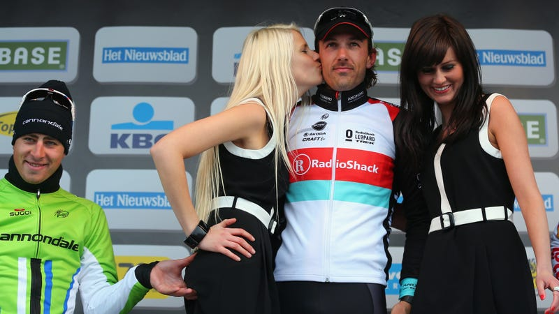 Cyclist Under Fire For Pinching A Podium Girl's Backside