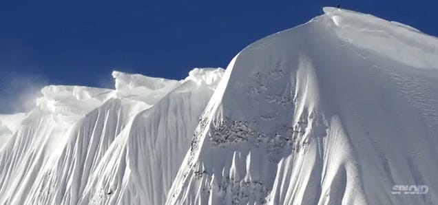 Holy cow, I can't believe this dude snowboarded down this snow wall