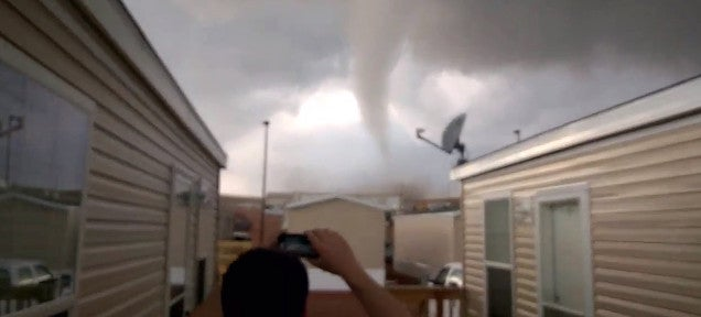 Mad guys laugh instead of fleeing as a tornado comes to destroy them