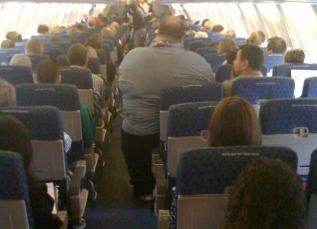 Self-Conscious Airplane Passenger Ends Up in Hospital After Refusing to Leave Seat for Fear of Exposing Fat Gut to Pretty Seatmate