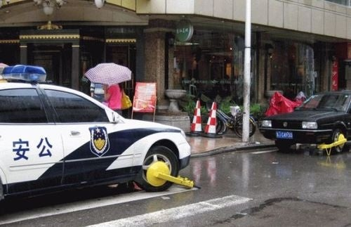 In Beijing, Even Cops Can't Park Illegally