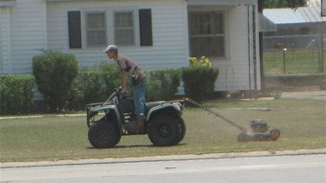 A Redneck Version of a Ride-On Lawn Mower