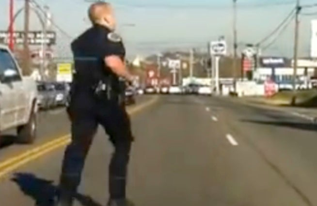 Out of Shape Cop Can't Chase Down Suspect Through Traffic