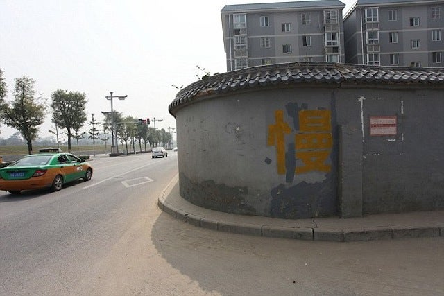 China Accidentally Built a Housing Complex in the Middle of a Highway