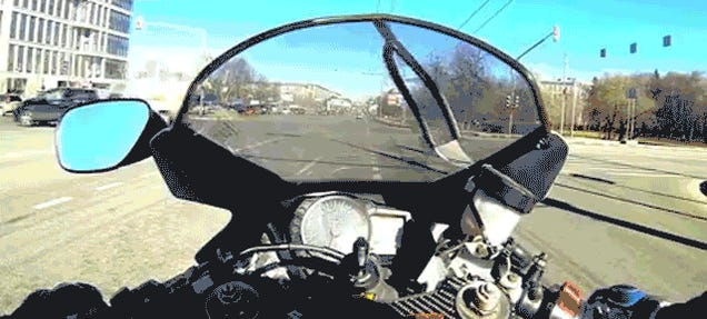 Biker Splits Lanes Like An Asshat With Predictable Results
