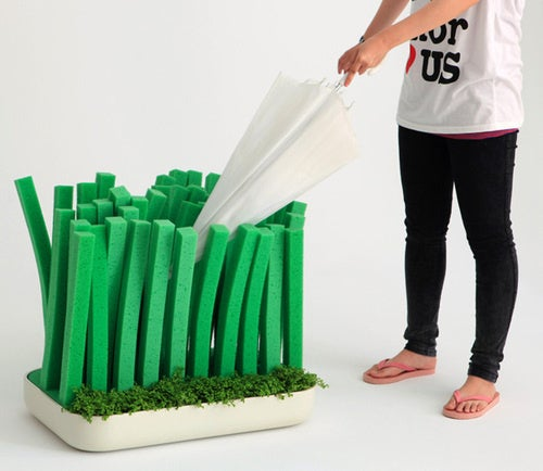 Dry Off Your Wet Umbrella In Styrofoam Grass