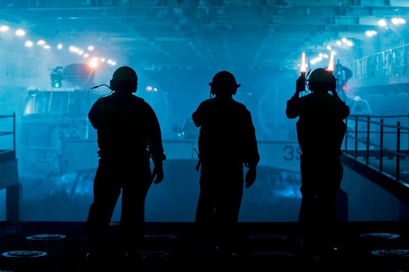 US Navy sailors inside an amphibious assault ship—or a lost Aliens scene